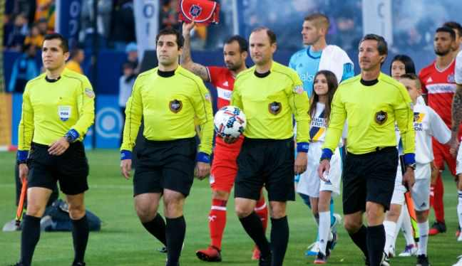 Kevin Stott, ball in hand, walking out alongside the crew for his 300th MLS game