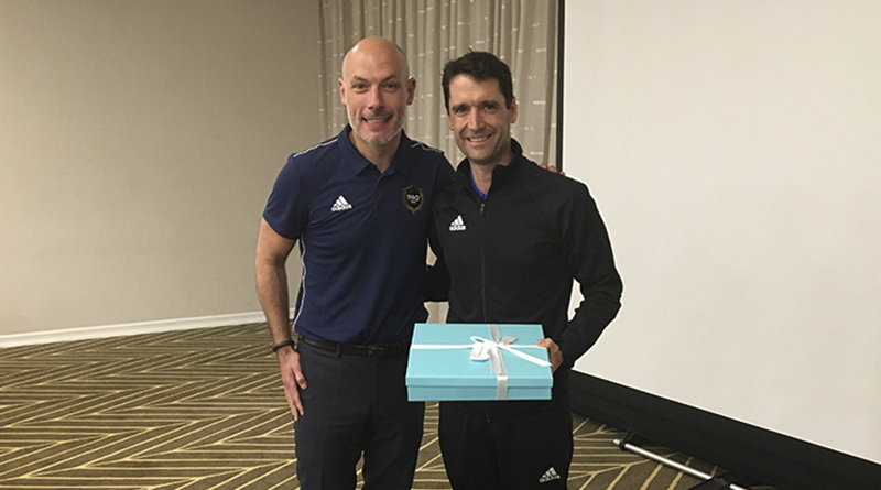 Frank Anderson receives a gift to mark his 200th #MLS regular season game from Howard Webb.