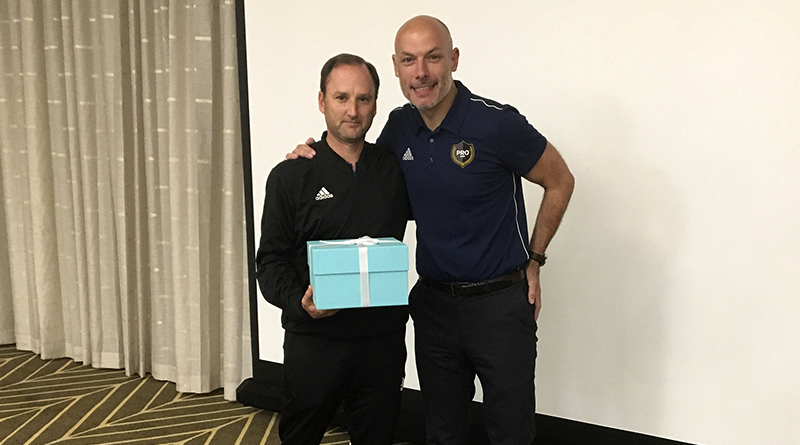 Kevin Stott receives a gift to mark his 300th MLS regular season game.