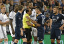 Benny Feilhaber talks with referee Baldomero Toledo