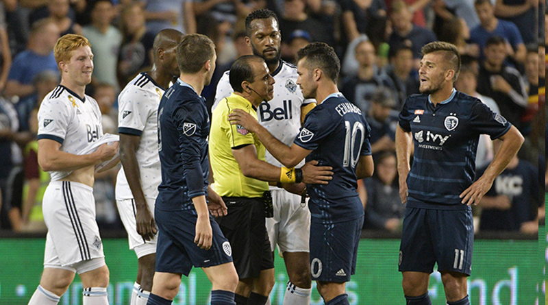Benny Feilhaber talks with referee Baldomero Toledo