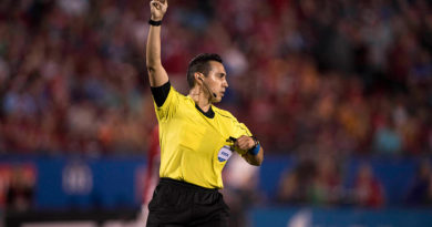 Jair Marrufo shows a yellow card.