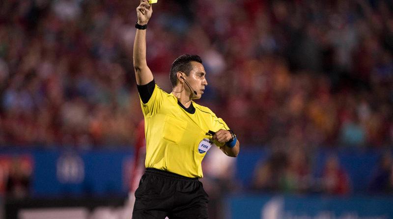Jair Marrufo shows a yellow card.