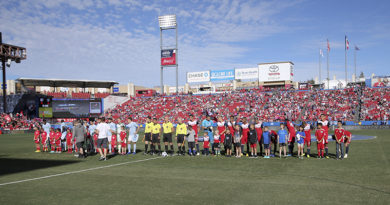 FC Dallas and Sporting Kansas City players stand for the national anthem before the match at Toyota Stadium.