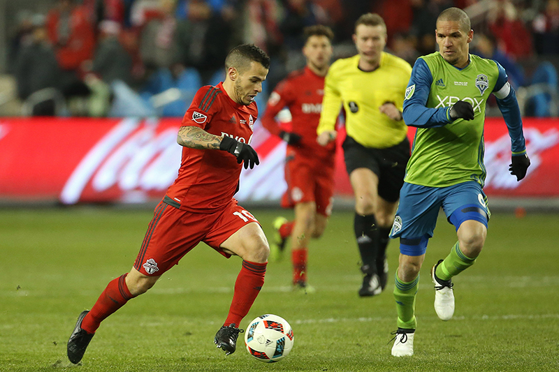 Alan Kelly looks on as Toronto FC forward Sebastian Giovinco dribbles the ball during the 2016 MLS Cup at BMO Field.