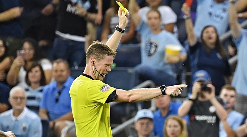 Drew Fischer issues a yellow card.