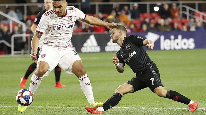 D.C. United forward Paul Arriola (7) is fouled while playing the ball by Real Salt Lake defender Marcelo Silva (30) in the first half at Audi Field.