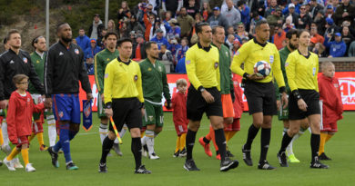 PRO officials lead FC Cincinnati, Portland Timbers and escort children onto the field before the inaugural MLS game at Nippert Stadium.