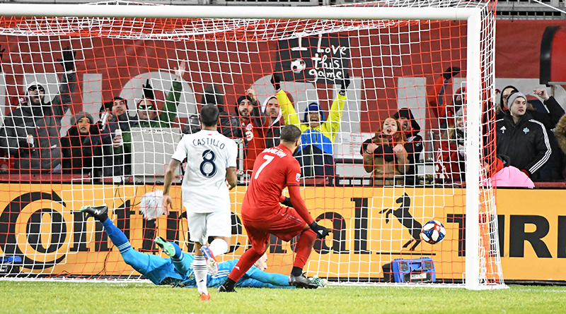 Toronto FC forward Jordan Hamilton scores a goal in the first half during the regular season MLS game against the New England Revolution at BMO Field.