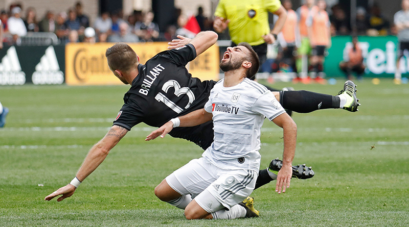 Los Angeles FC forward Diego Rossi (9) is fouled by D.C. United defender Frederic Brillant (13) at Audi Field.
