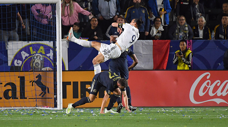 Los Angeles Galaxy forward Zlatan Ibrahimovic is upended by Philadelphia Union's Kai Wagner and Auston Trusty as he attempts to head the ball.