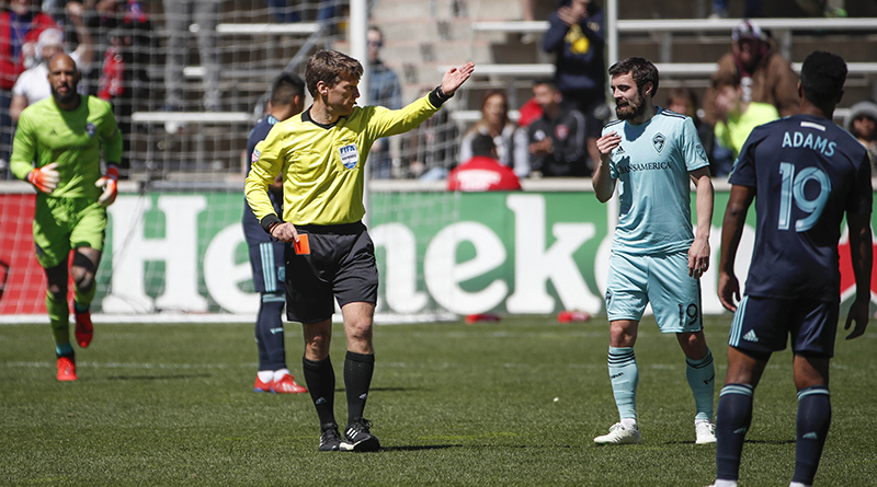 Colorado Rapids midfielder Jack Price receives a red card after a foul against Chicago Fire midfielder Brandt Bronico during the second half at Bridgeview Stadium.