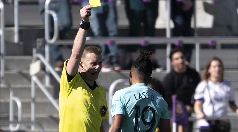 Vancouver Whitecaps forward Alhassane Bangoura receives a yellow card during the second half against the Orlando City at Orlando City Stadium.