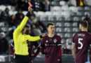 Colorado Rapids midfielder Cole Bassett (26) watches as defender Tommy Smith (5) is red carded by MLS referee Marcos DeOliveira during the second half against the Houston Dynamo.