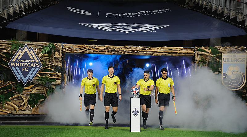 The referee crew enter the field before the start of the first half as the Vancouver Whitecaps host the Los Angeles FC at BC Place.