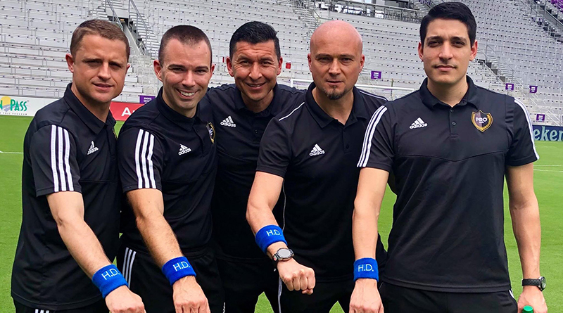 Gjovalin Bori, Chris Penso, Jorge Gonzalez, Robert Sibiga and Nick Uranga show their support for Huntington's Disease Awareness Month by wearing blue wristbands.