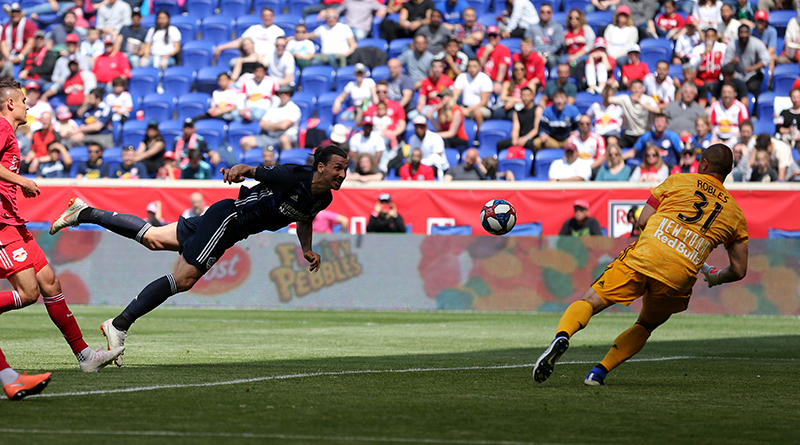LA Galaxy forward Zlatan Ibrahimovic heads the ball past New York Red Bulls goalie Luis Robles for a goal during the first half at Red Bull Arena.
