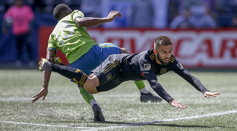 Seattle Sounders FC defender Kelvin Leerdam fouls Los Angeles FC forward Diego Rossi during the second half at CenturyLink Field.