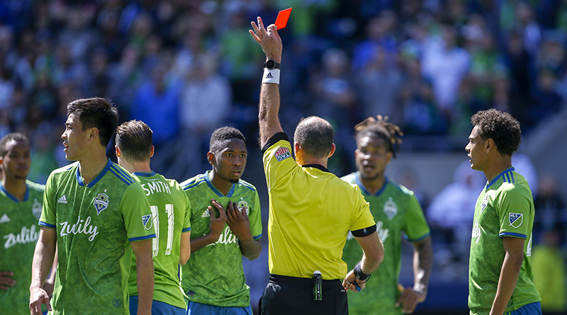 Referee Ted Unkel gives a red card to Seattle Sounders defender Kelvin Leerdam after a foul on Los Angeles FC forward Diego Rossi during the second half at CenturyLink Field.