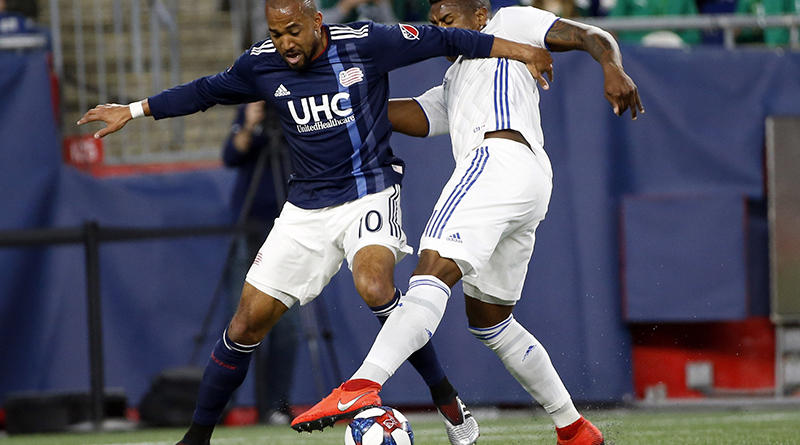 New England Revolution midfielder Teal Bunbury battles with San Jose Earthquakes defender Harold Cummings during the first half at Gillette Stadium.