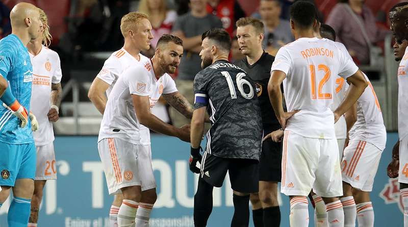 Atlanta United's Leandro Gonzalez Pirez (5) argues with Toronto FC goalkeeper Quentin Westberg (16) in over time as a penalty kick would be called upon video review at BMO Field.