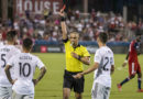 D.C. United midfielder Luciano Acosta (10) is issued a red card during the second half against FC Dallas at Toyota Stadium.