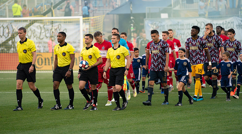 Philadelphia Union and Chicago Fire are escorted onto the field by young fans before a game at Talen Energy Stadium.