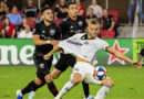 Philadelphia Union forward Kacper Przybylko (23) is pulled down by D.C. United midfielder Junior Moreno (5) during the first half at Audi Field.