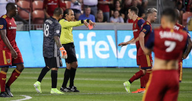 Referee Baldomero Toledo rescinds a red card given to Real Salt Lake defender Aaron Herrera (22) during the first half against the Los Angeles FC after reviewing the call during the first half at Rio Tinto Stadium.