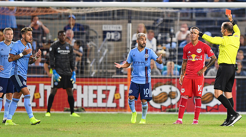 New York City FC defender Ronald Matarrita (22) receives a red card against the New York Red Bulls during the second half at Yankee Stadium.