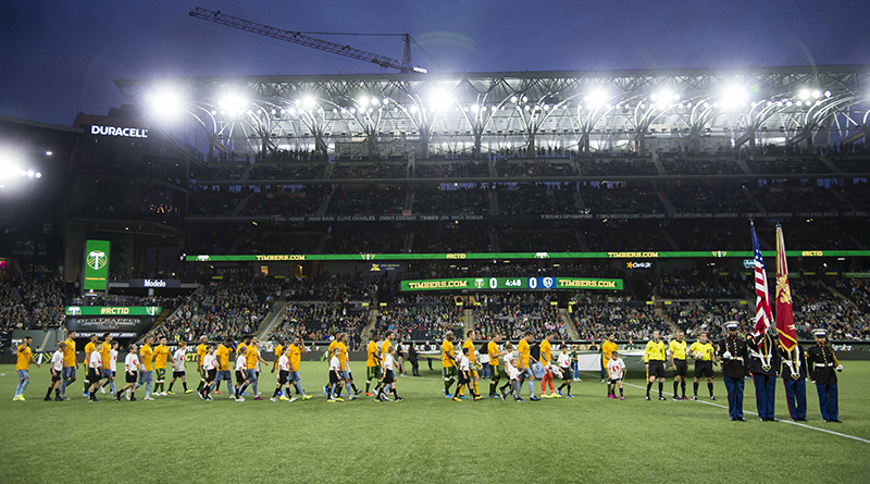 Portland Timbers and Sporting Kansas City walk onto the field before a game at Providence Park.