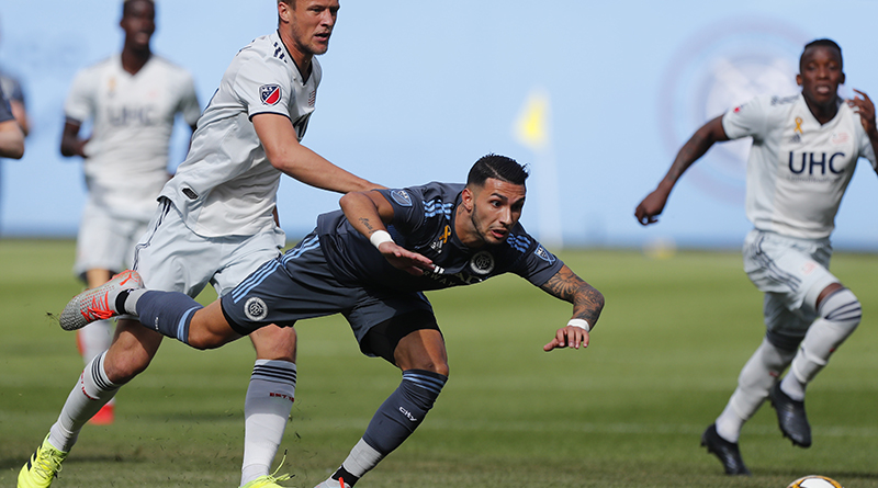New England Revolution defender Antonio Delamea Mlinar (19) pushes New York City FC midfielder Valentin Castellanos (11) during the first half at Yankee Stadium.