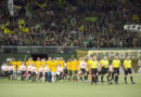 Portland Timbers and New England Revolution take the field before a game at Providence Park.