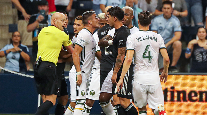 Portland Timbers forward Brian Fernandez (7) and Sporting Kansas City midfielder Felipe Gutierrez (21) are separated by teammates after a play during the first half at Children's Mercy Park.