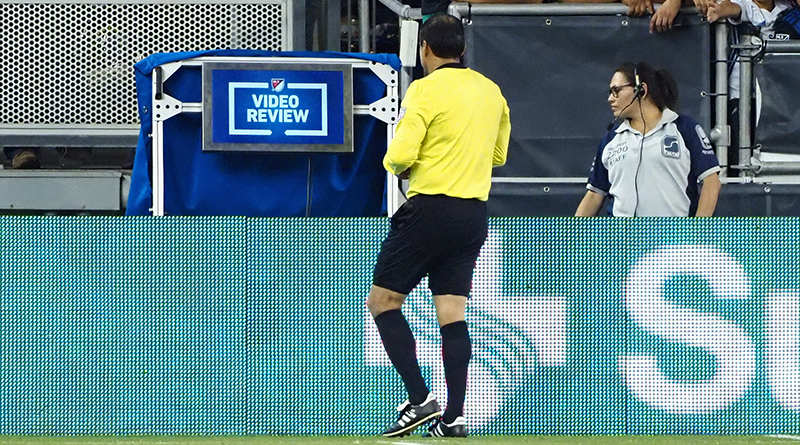 Referee Baldomero Toledo checks the video review during the second half between the San Jose Earthquakes and the Philadelphia Union at Avaya Stadium.