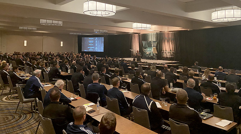Keynote speaker Bob Delaney addresses the audience during PRO's preseason camp in January 2020.