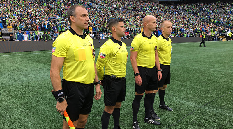 The 2019 MLS Cup crew wait to be presented with their medals at CenturyLink Field.