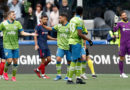 Seattle Sounders FC forward Jordan Morris (left) high fives midfielder Cristian Roldan (middle) after scoring the game winner goal against the Chicago Fire during the second half stoppage time at CenturyLink Field.