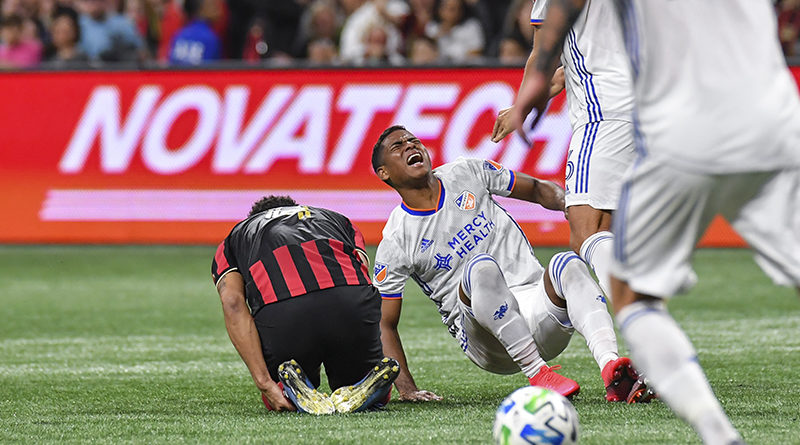 FC Cincinnati midfielder Allan Cruz (8) reacts as he collides with Atlanta United defender Anton Walkes (4) during the second half at Mercedes-Benz Stadium.