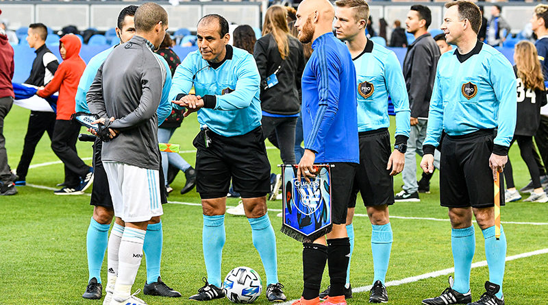 Captains from the Minnesota United and San Jose Earthquakes wait for the coin toss before a match at Earthquakes Stadium.