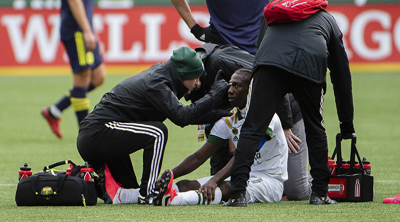 Portland Timbers midfielder Diego Chara (21) is looked after by a trainer during the second half against Nashville at Providence Park.