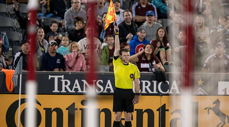 AR Eric Weisbrod calls for an offside in the second half of the match between the Minnesota United and the Colorado Rapids at Dick's Sporting Goods Park.