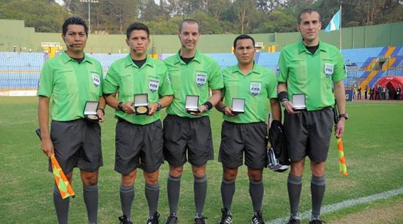 Adam Wienckowski with PRO colleague Mark Geiger after the 2011 Concacaf U-20 Final in Guatemala City.