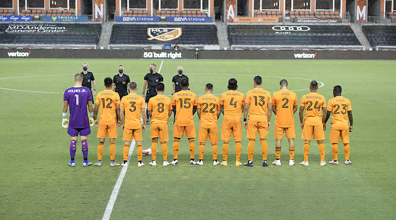 Houston Dynamo starting XI pose for a photo wearing jerseys with the names of pediatric cancer patients on them.