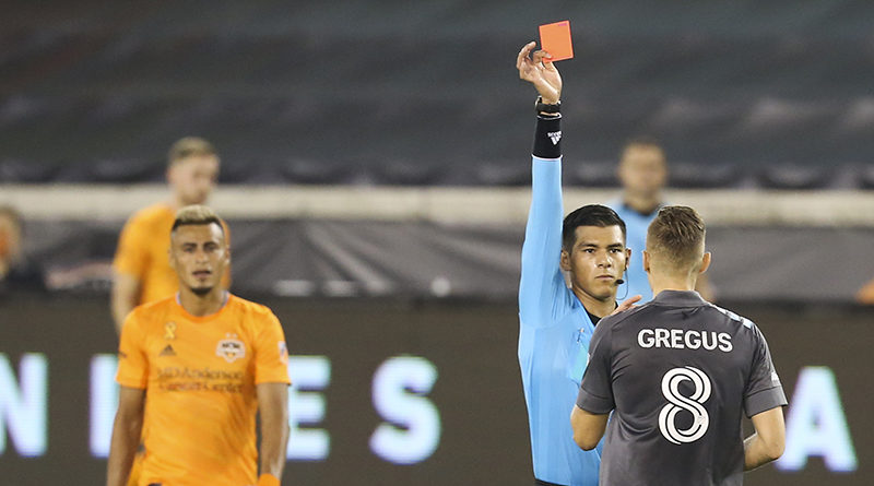 Minnesota United midfielder Jan Gregus receives a red card from referee Victor Rivas while playing against the Houston Dynamo in the second half at BBVA Stadium.