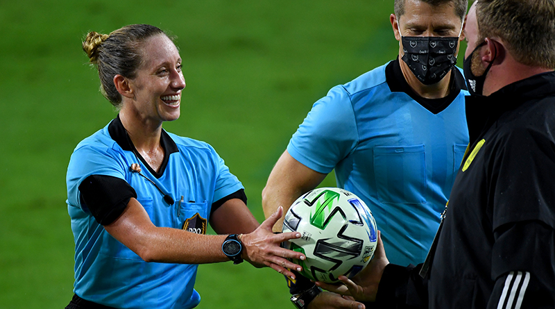 Referee Tori Penso is given a game ball after being the first female in 20 years to referee an MLS match.