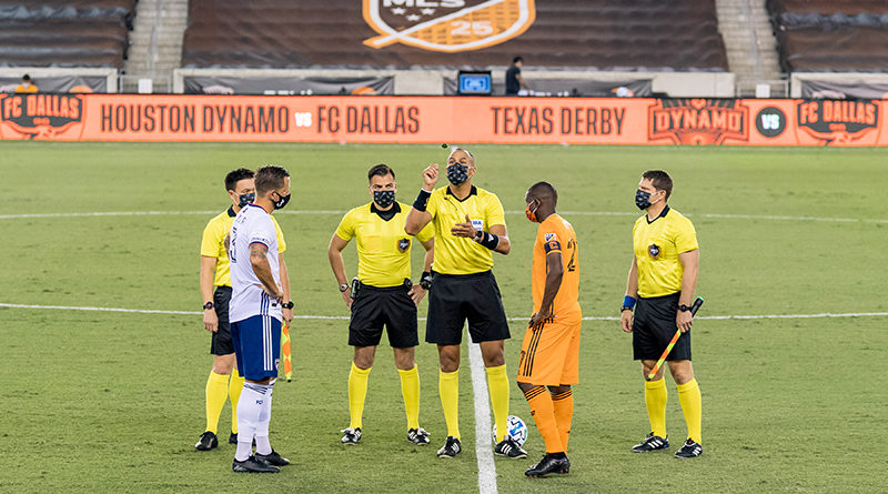 PRO match officials with FC Dallas defender Reto Ziegler (3) and Houston Dynamo midfielder Boniek Garcia (27) prior to the match at BBVA Stadium.