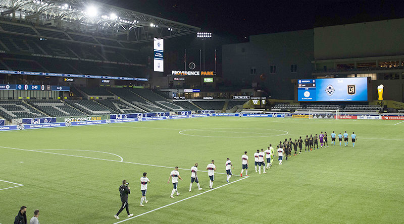 Los Angeles FC and the Vancouver Whitecaps take the field before a game at Providence Park.