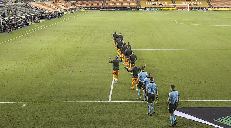 Houston Dynamo and Columbus Crew enter the pitch before the game at BBVA Stadium.