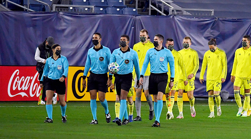 PRO officials lead our Nashville and Chicago Fire players take the field before the match at Nissan Stadium.